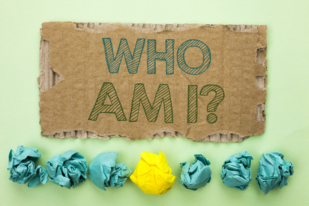 Conceptual hand writing showing Who Am I Question. Business photo text Question Asked Identity Thinking Doubt Psycology Mystery written Tear Cardboard plain background Crumpled Paper Balls.