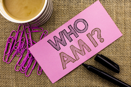 Handwriting text writing Who Am I Question. Concept meaning Question Asked Identity Thinking Doubt Psycology Mystery written Pink Sticky Note Paper the jute background Coffee Cup Pen Pins. Stock fotó