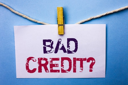 Text sign showing Bad Credit Question. Conceptual photo Low Credit Finance Economic Budget Asking Questionaire written White Note Paper hanging with rope the plain background Clip.