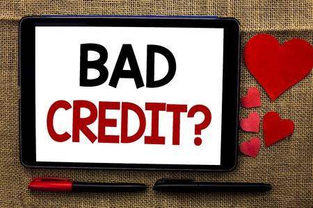 Handwriting text writing Bad Credit Question. Concept meaning Low Credit Finance Economic Budget Asking Questionaire written Tablet the jute background Hearts and Pens next to it. Stock Photo