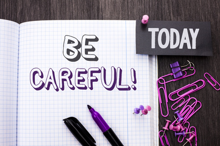 Handwriting text Be Careful. Concept meaning Caution Warning Attention Notice Care Beware Safety Security written Notebook Book wooden background Today with Thumbpin Marker Paper Clip. Stok Fotoğraf