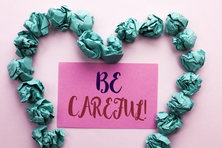 Word writing text Be Careful. Business concept for Caution Warning Attention Notice Care Beware Safety Security written Pink Sticky Note Paper the plain background Heart.