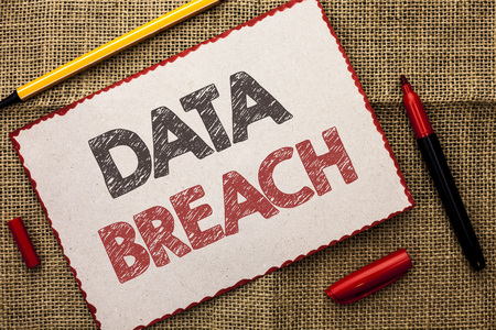Data Breach. Business photo showcasing Stolen Cybercrime Information Hacking Security Malicious Crack written Cardboard Piece the jute background Markers next to it. Stock Photo