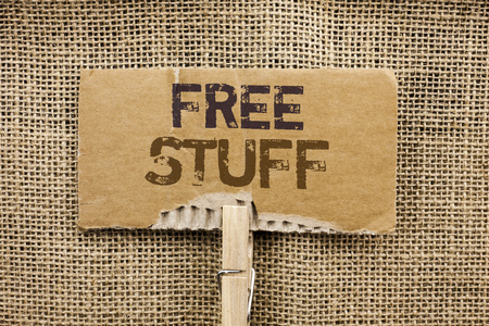 Writing note showing  Free Stuff. Business photo showcasing Complementary Free of Cost Chargeless Gratis Costless Unpaid written Cardboard Piece Holding By Clip the jute background.