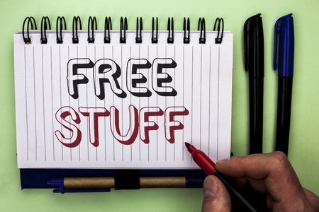 Writing note showing  Free Stuff. Business photo showcasing Complementary Free of Cost Chargeless Gratis Costless Unpaid written by Man Holding Marker Nootbook Book plain background Marker.