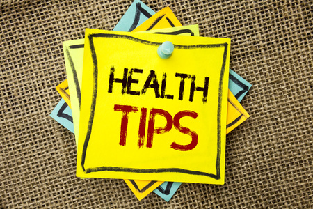 Text sign showing Health Tips. Conceptual photo Healthy Suggestions Suggest Information Guidance Tip Idea written Sticky Note Paper attached to jute background with Thumbpin it. 스톡 콘텐츠