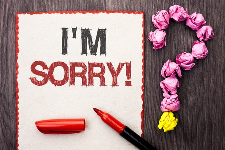 Writing note showing  I m Sorry. Business photo showcasing Apologize Conscience Feel Regretful Apologetic Repentant Sorrowful written Cardboard Piece With Marker wooden background Question Mark.