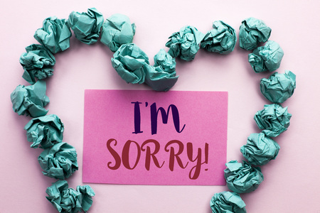 Word writing text I m Sorry. Business concept for Apologize Conscience Feel Regretful Apologetic Repentant Sorrowful written Pink Sticky Note Paper the plain background Heart.