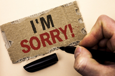 Writing note showing  I m Sorry. Business photo showcasing Apologize Conscience Feel Regretful Apologetic Repentant Sorrowful written by Man Holding Marker tear Cardboard Piece Plain Background. Stock Photo