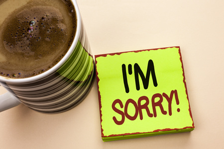 Word writing text I m Sorry. Business concept for Apologize Conscience Feel Regretful Apologetic Repentant Sorrowful written Green Sticky Note Paper the plain background Coffee Cup next to it.