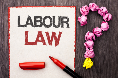 Writing note showing  Labour Law. Business photo showcasing Employment Rules Worker Rights Obligations Legislation Union written Cardboard Piece With Marker wooden background Question Mark.