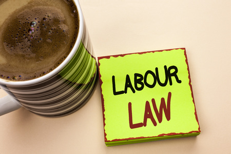 Word writing text Labour Law. Business concept for Employment Rules Worker Rights Obligations Legislation Union written Green Sticky Note Paper the plain background Coffee Cup next to it.