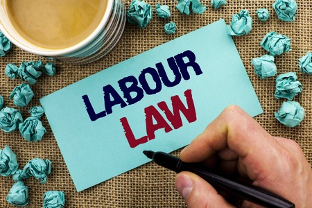 Writing note showing  Labour Law. Business photo showcasing Employment Rules Worker Rights Obligations Legislation Union written by Man Holding Pen Sticky Note Paper the jute background Cup Stock Photo