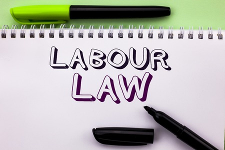 Conceptual hand writing showing Labour Law. Business photo showcasing Employment Rules Worker Rights Obligations Legislation Union written Notebook Book the Plain background Marker Pen