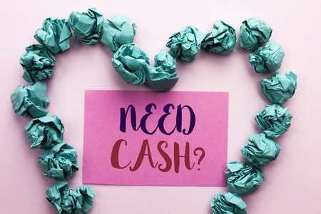 Word writing text Need Cash Question. Business concept for Wealth Question Needy Currency Money Advice Conceptual written Pink Sticky Note Paper the plain background Heart.