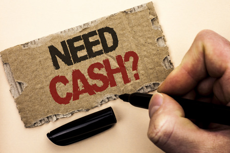 Writing note showing  Need Cash Question. Business photo showcasing Wealth Question Needy Currency Money Advice Conceptual written by Man Holding Marker tear Cardboard Piece Plain Background.