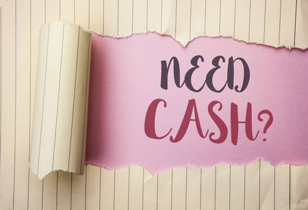 Writing note showing  Need Cash Question. Business photo showcasing Wealth Question Needy Currency Money Advice Conceptual written the pink background behind Tear Notebook Paper. Stock Photo