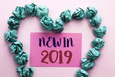 Word writing text New In 2019. Business concept for Fresh Era Latest Year Period Season Annual Coming Modern written Pink Sticky Note Paper the plain background Heart.