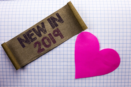 Handwriting text New In 2019. Concept meaning Fresh Era Latest Year Period Season Annual Coming Modern written Cardboard Piece the check background Heart next to it. Stock fotó