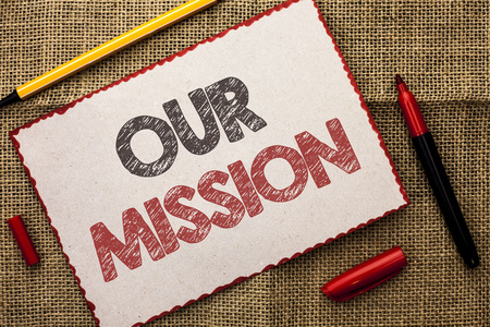 Writing note showing  Our Mission. Business photo showcasing Goal Motivation Target Growth Planning Innovation Vision written Cardboard Piece the jute background Markers next to it. Stock Photo