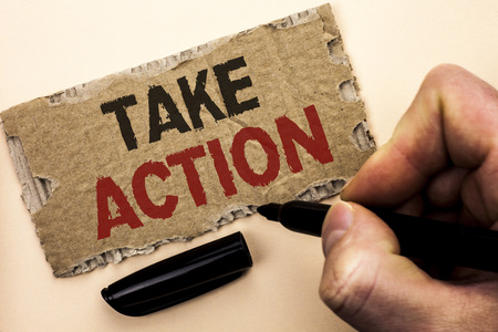 Writing note showing  Take Action. Business photo showcasing Strategy Future Actions Procedure Activity Goal Objective written by Man Holding Marker tear Cardboard Piece Plain Background.