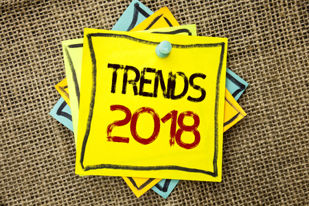 Text sign showing Trends 2018. Conceptual photo Current Movement Latest Modern Branding New Concept Prediction written Sticky Note Paper attached to jute background with Thumbpin it.