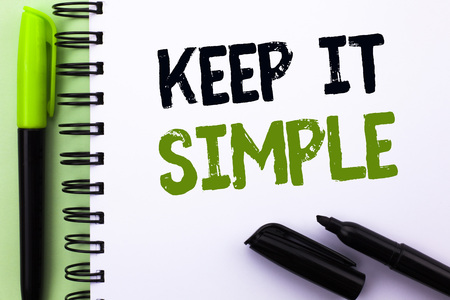 Text sign showing Keep It Simple. Conceptual photo Simplify Things Easy Understandable Clear Concise Ideas written Notebook Book the Green background Marker and Pen next to it. Stock Photo - 99288072