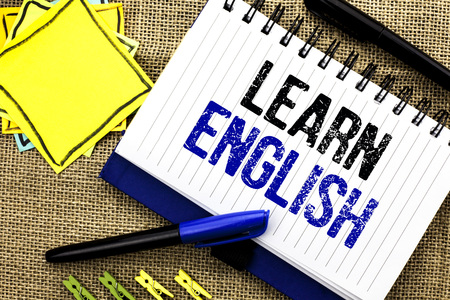 Conceptual hand writing showing Learn English. Business photo showcasing Study another Language Learn Something Foreign Communication written Notebook Book the jute background Clips and Pens