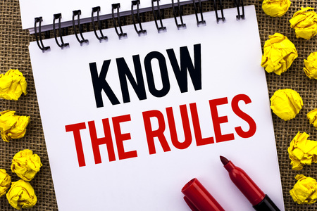 Handwriting text Know The Rules. Concept meaning Be aware of the Laws Regulations Protocols Procedures written Notebook Book the jute background Marker next to it.
