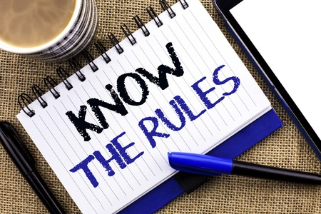 Text sign showing Know The Rules. Conceptual photo Be aware of the Laws Regulations Protocols Procedures written Notebook Book the jute background Tablet Coffee Cup and Pens next to it