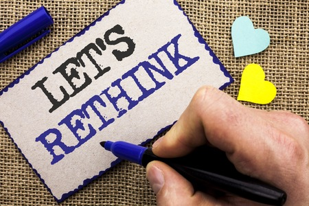Conceptual hand writing showing Let Us Rethink. Business photo showcasing Give people time to think things again Remodel Redesign written Sticky Note the jute bakground with Love Hearts.