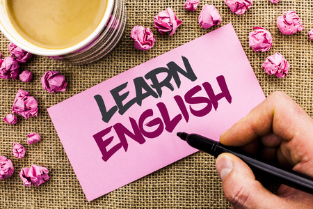 Conceptual hand writing showing Learn English. Business photo text Study another Language Learn Something Foreign Communication written by Man Holding Marker Paper the jute background Cup