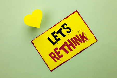 Word writing text Let Us Rethink. Business concept for Give people time to think things again Remodel Redesign written Yellow Sticky Note Paper the Plain background Heart next to it.