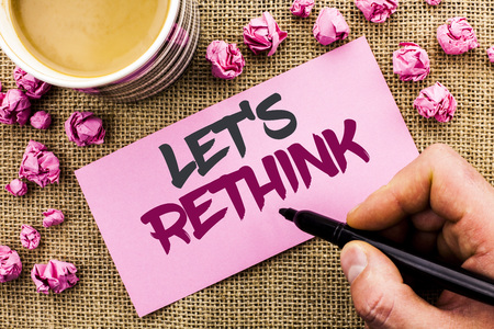 Conceptual hand writing showing Let Us Rethink. Business photo text Give people time to think things again Remodel Redesign written by Man Holding Marker Paper the jute background Cup