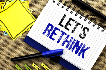 Conceptual hand writing showing Let Us Rethink. Business photo showcasing Give people time to think things again Remodel Redesign written Notebook Book the jute background Clips and Pens Stock Photo