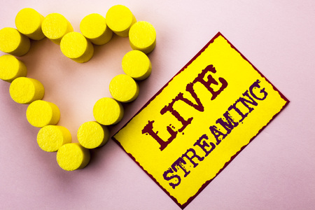 Handwriting text writing Live Streaming. Concept meaning Media real-time transmission Multimedia Technology Broadcast written Yellow Sticky Note Paper Plain background with Heart next to it.