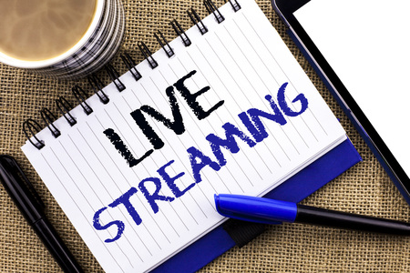 Text sign showing Live Streaming. Conceptual photo Media real-time transmission Multimedia Technology Broadcast written Notebook Book the jute background Tablet Coffee Cup and Pens next to it
