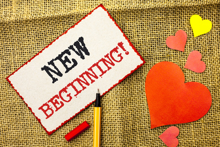 Handwriting text New Beginning Motivational Call. Concept meaning Fresh Start Changing Form Growth Life written Sticky Note Paper by Pointer the jute background Love Hearts next to it. Stock Photo
