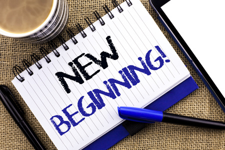 Text sign showing New Beginning Motivational Call. Conceptual photo Fresh Start Changing Form Growth Life written Notebook Book the jute background Tablet Coffee Cup and Pens next to it