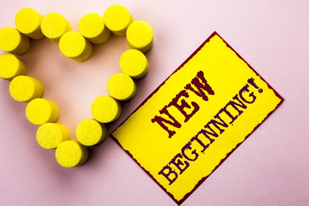 Handwriting text writing New Beginning Motivational Call. Concept meaning Fresh Start Changing Form Growth Life written Yellow Sticky Note Paper Plain background with Heart next to it.