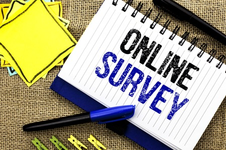 Conceptual hand writing showing Online Survey. Business photo showcasing Digital Media Poll Customer Feedback Opinions Questionnaire written Notebook Book the jute background Clips and Pens