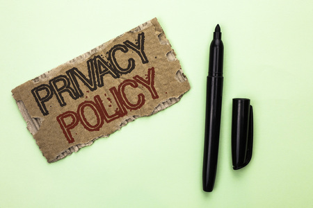 Word writing text Privacy Policy. Business concept for Document Information Security Confidential Data Protection written Tear Cardboard Piece the plain background Marker next to it.