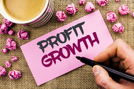 Conceptual hand writing showing Profit Growth. Business photo text Financial Success Increased Revenues Evolution Development written by Man Holding Marker Paper the jute background Cup
