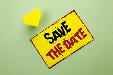 Word writing text Save The Date. Business concept for Remember not to schedule anything else that time Appointment written Yellow Sticky Note Paper the Plain background Heart next to it.