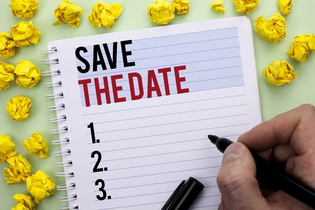 Writing note showing  Save The Date. Business photo showcasing Remember not to schedule anything else that time Appointment written By Man Holding Marker Notebook Paper. 写真素材