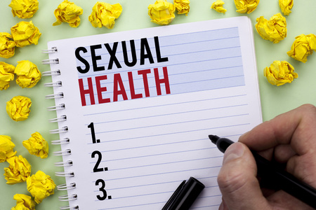 Writing note showing  Sexual Health. Business photo showcasing STD prevention Use Protection Healthy Habits Sex Care written By Man Holding Marker Notebook Paper.