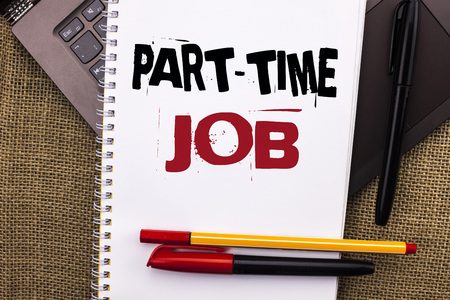 Writing note showing  Part Time Job. Business photo showcasing Working a few hours per day Temporary Work Limited Shifts written Notebook Book placed Laptop with jute background Pens