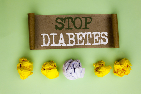 Handwriting text Stop Diabetes. Concept meaning Take care of your Sugar Levels Healthy Diet Nutrition Habits written Cardboard Paper the plain background Paper Balls next to it.