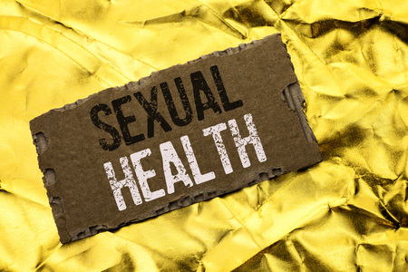 Writing note showing  Sexual Health. Business photo showcasing STD prevention Use Protection Healthy Habits Sex Care written tear Cardboard Piece the Golden textured background.
