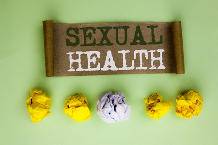 Handwriting text Sexual Health. Concept meaning STD prevention Use Protection Healthy Habits Sex Care written Cardboard Paper the plain background Paper Balls next to it. Stock Photo